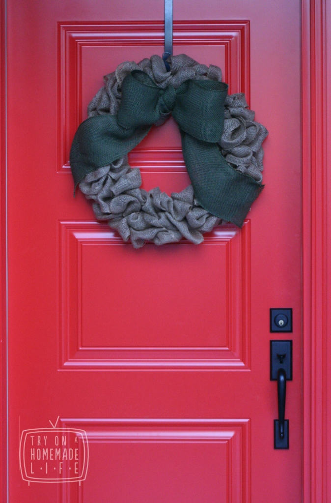 A burlap wreath on a red door. Is there a more perfect combo?